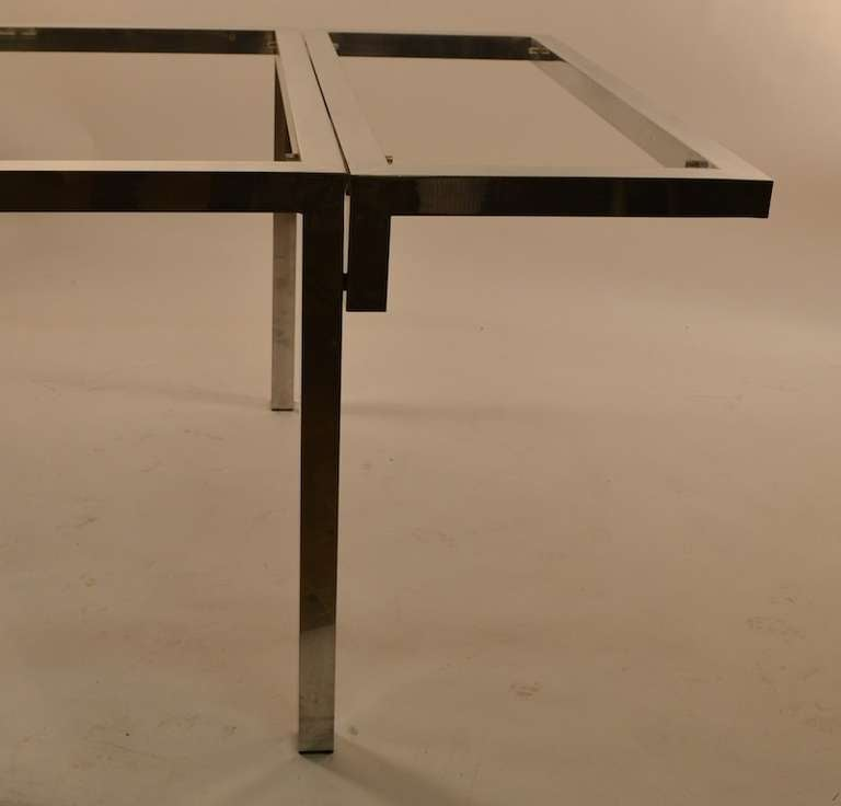 Unusual cast aluminum extension dining table with wall for Unusual extending dining tables