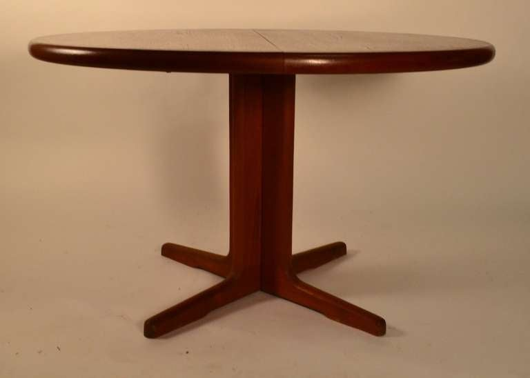 this round teak danish modern dining table with two leaves is no