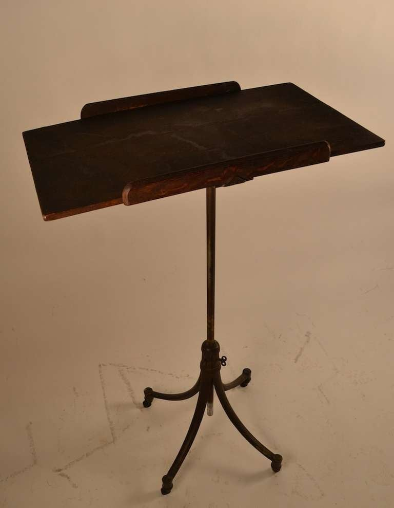 Antique Industrial stand - cast iron, with oak top. The top will tip and the vertical post will raise and lower, to adjust height.  Great as pedestal, Maitre d stand or drafting table.  Top surface, 25.5 x 16