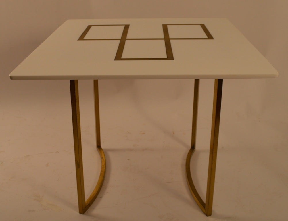 Interesting end, lamp, occasional, end table, with thick white glass top with engraved gold geometric surface, on square brass legs. Probably 1960's American production, after McCobb.