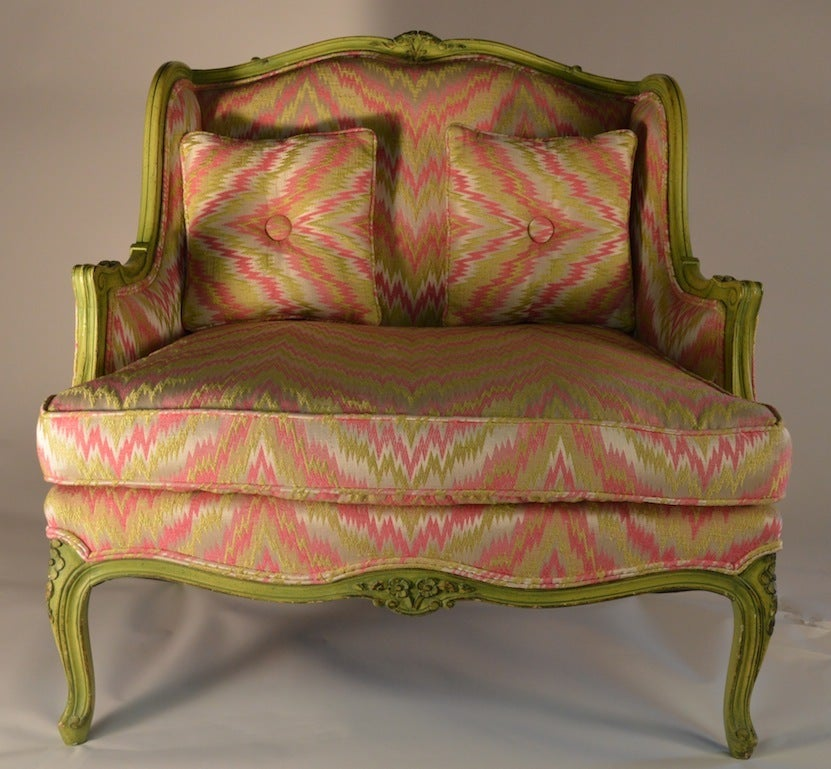 Bigger than a chair, smaller than a loveseat. French style frame in lime green, with colorful flame stitch fabric. Probably American made, in the French style.