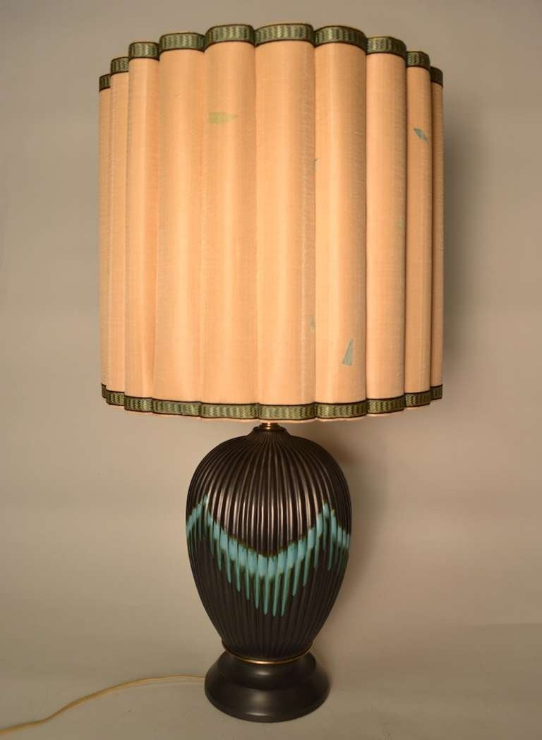 Drip glaze fluted ceramic body, original shade and finial. Gun metal ground with turquoise drip decoration. Working condition.