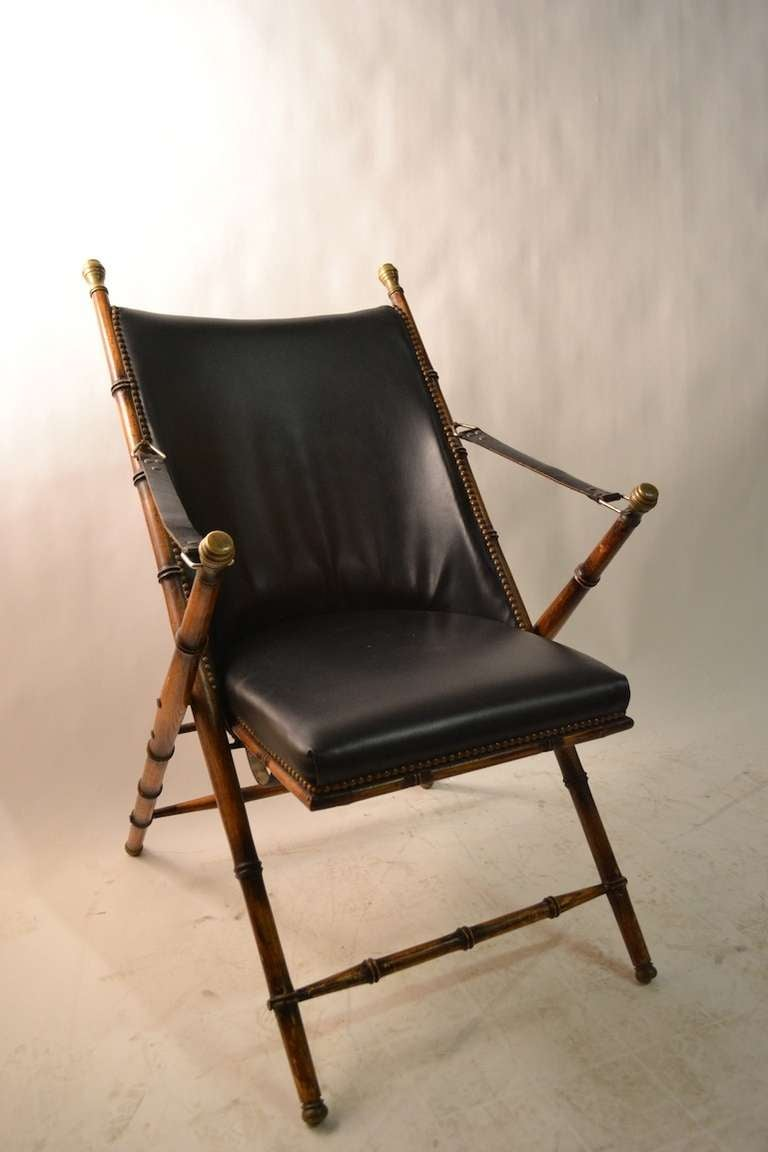 Pair Campaign chairs made in Italy for La Barge. Faux bamboo oak frames, leather strap arm rests, vinyl seat and back.