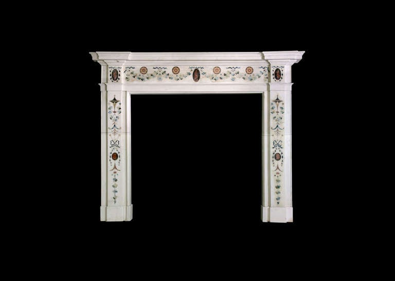 Late 18th century Irish mantel in the manner of Pietro Bossi in statuary marble with inlays of vine leaves, flowers, classical figures and cameos. Opening dimensions: 47.13