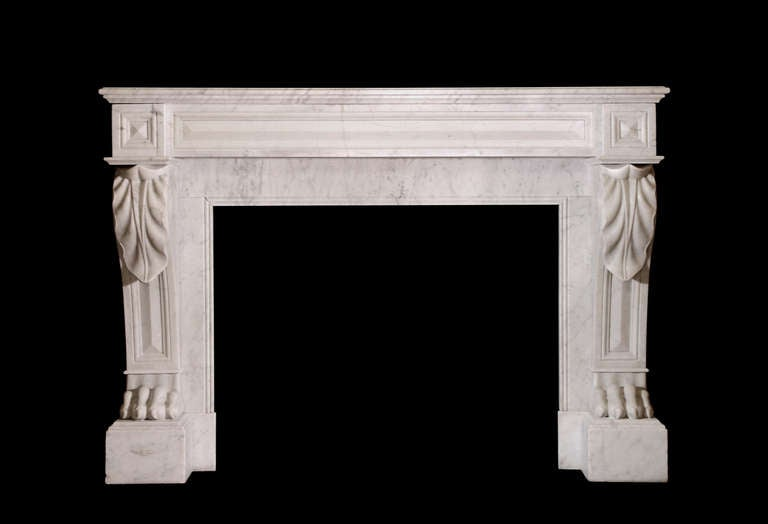 An imposing 19th century French marble chimneypiece in the Empire style with lion's paw feet above the plinth blocks supporting paneled jambs terminating in acanthus leaf carving beneath fielded corner blocks and conforming frieze. Opening: 37 3/4