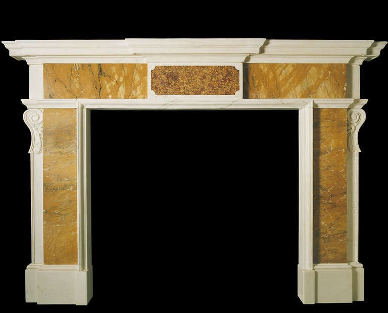 Mid-18th century mantel of architectural form, with panels of convent siena to the pilasters and frieze, the latter flanking a centre inset of spanish brocatella and the former with side projecting corbels. Opening dimensions: 48.25