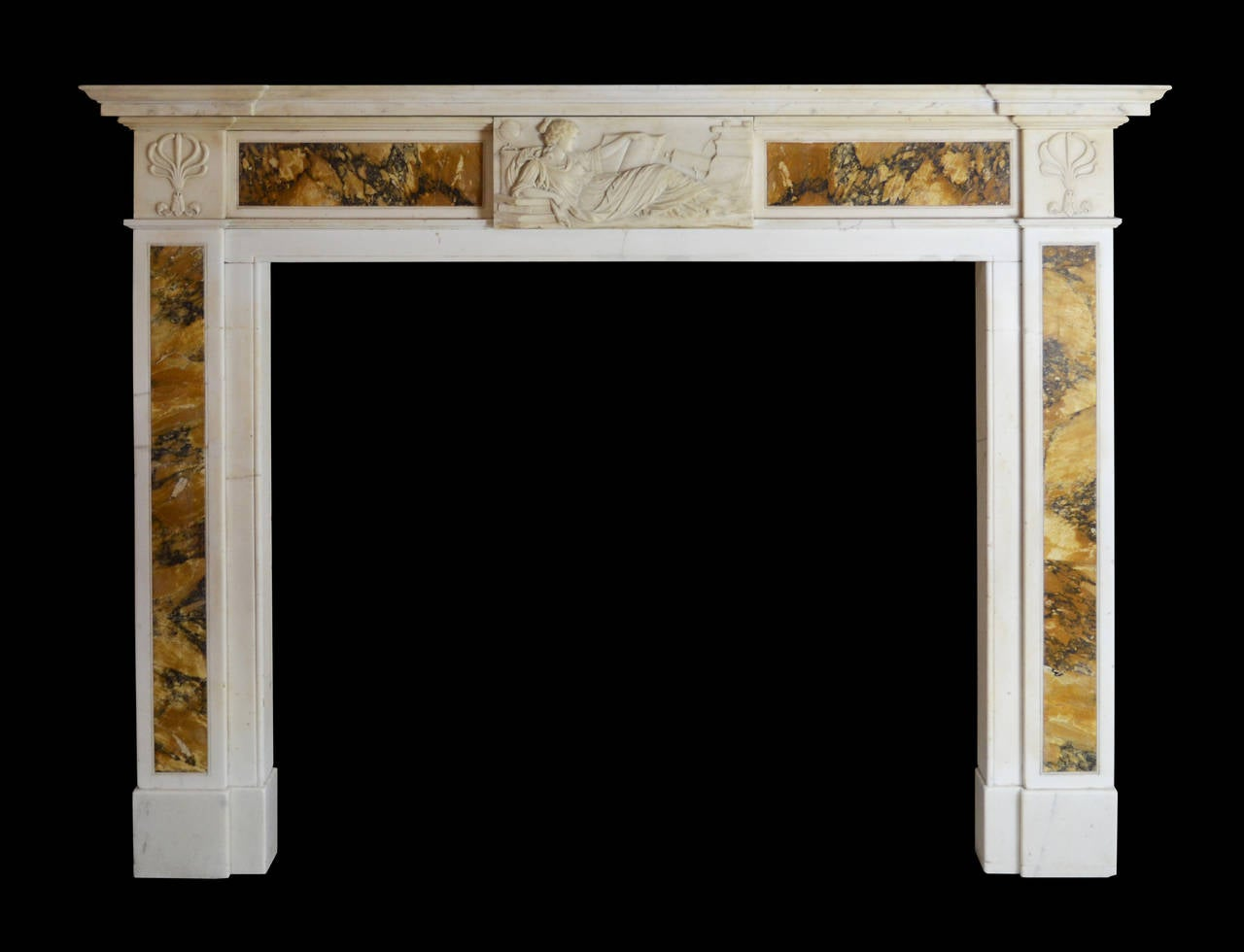 Regency mantel in statuary marble with Siena inlay and astronomical centre tablet detail. Opening dimension: 48 1/4