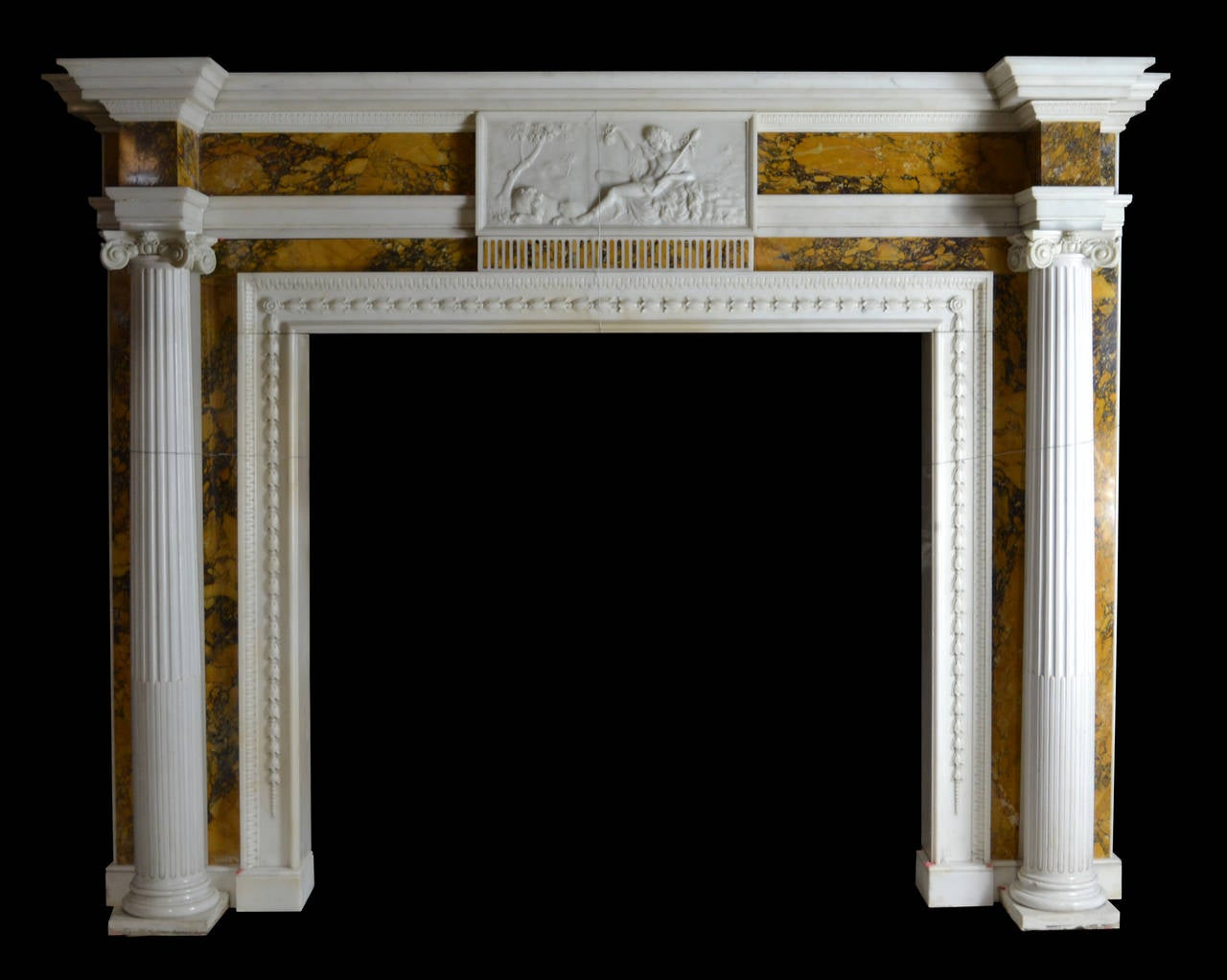 An imposing late 18th century Irish chimneypiece in Italian statuary with richly colored and strongly veined Convent Siena marble inlay, circa 1790.
