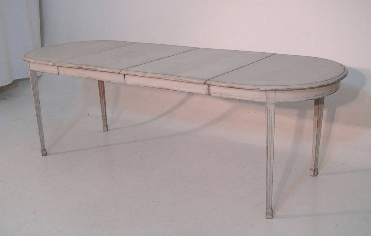 A Swedish Gustavian Style painted extension table with two leaves, circa 1900.  Measures: Height: 29