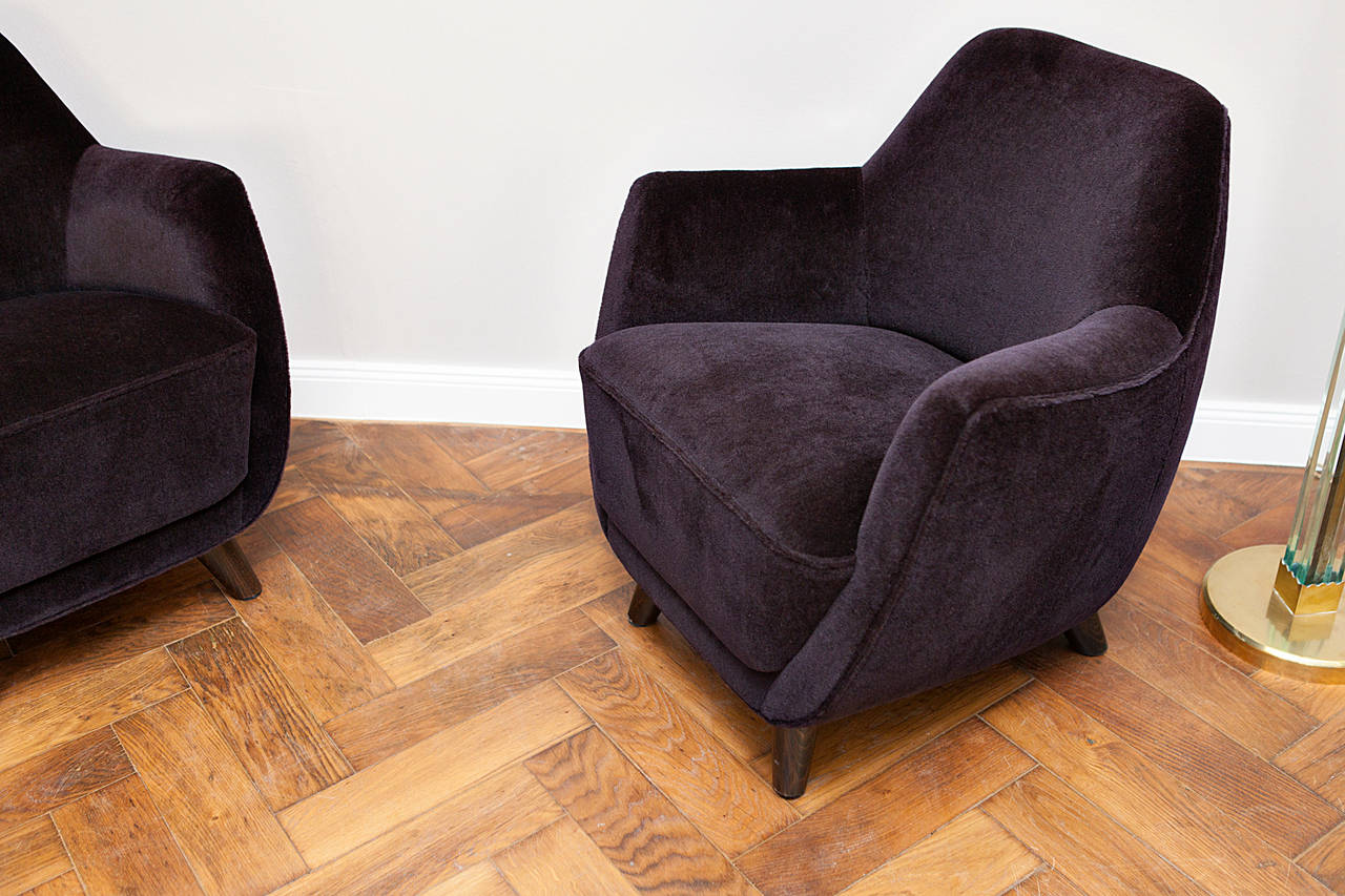 "A pair of chairs by Gio Ponti, new ""Teddy"" fabric by Dedar, Italy circa 1955, Mohair dark blackberry colored, wooden feets, wooden frame, height quality upholstery work.