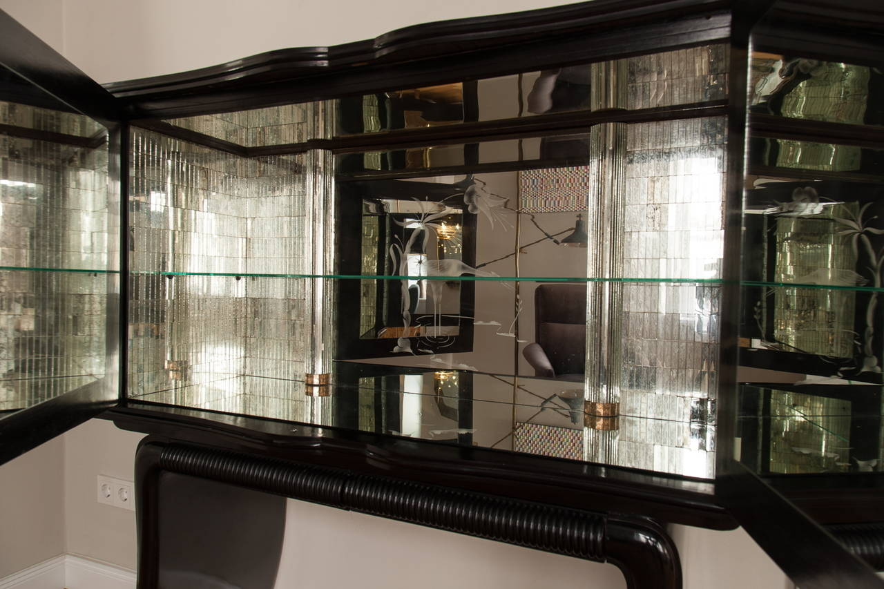 Elegant bar cabinet, Italy, circa 1950, by Paolo Buffa (1903-1970) ,professional restored wood shellac polished surface, two curved doors with nickel-plated brass handles, centrally a mirror etched with star and circles motifs, organically curved