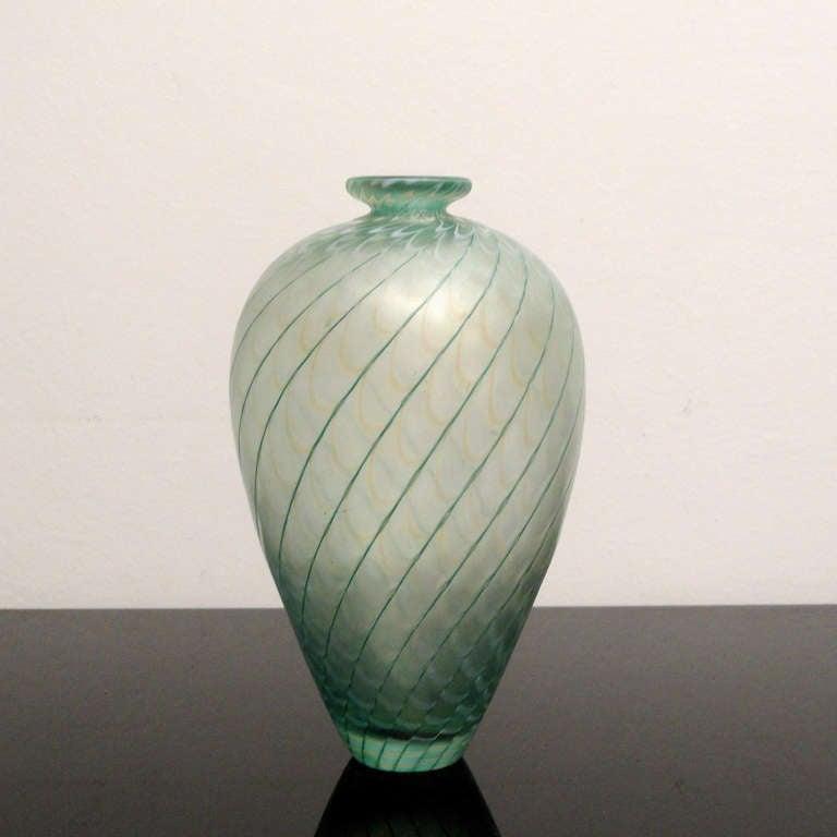 "Baluster vase ""Fenicio"", circa 1970. Design: Bertil Vallien. Execution: Kosta Boda.  Transparent body light green glass round decorated with dark green spirals and opaque-white waves ""Fenicio"" iridiscent.  Engraved"