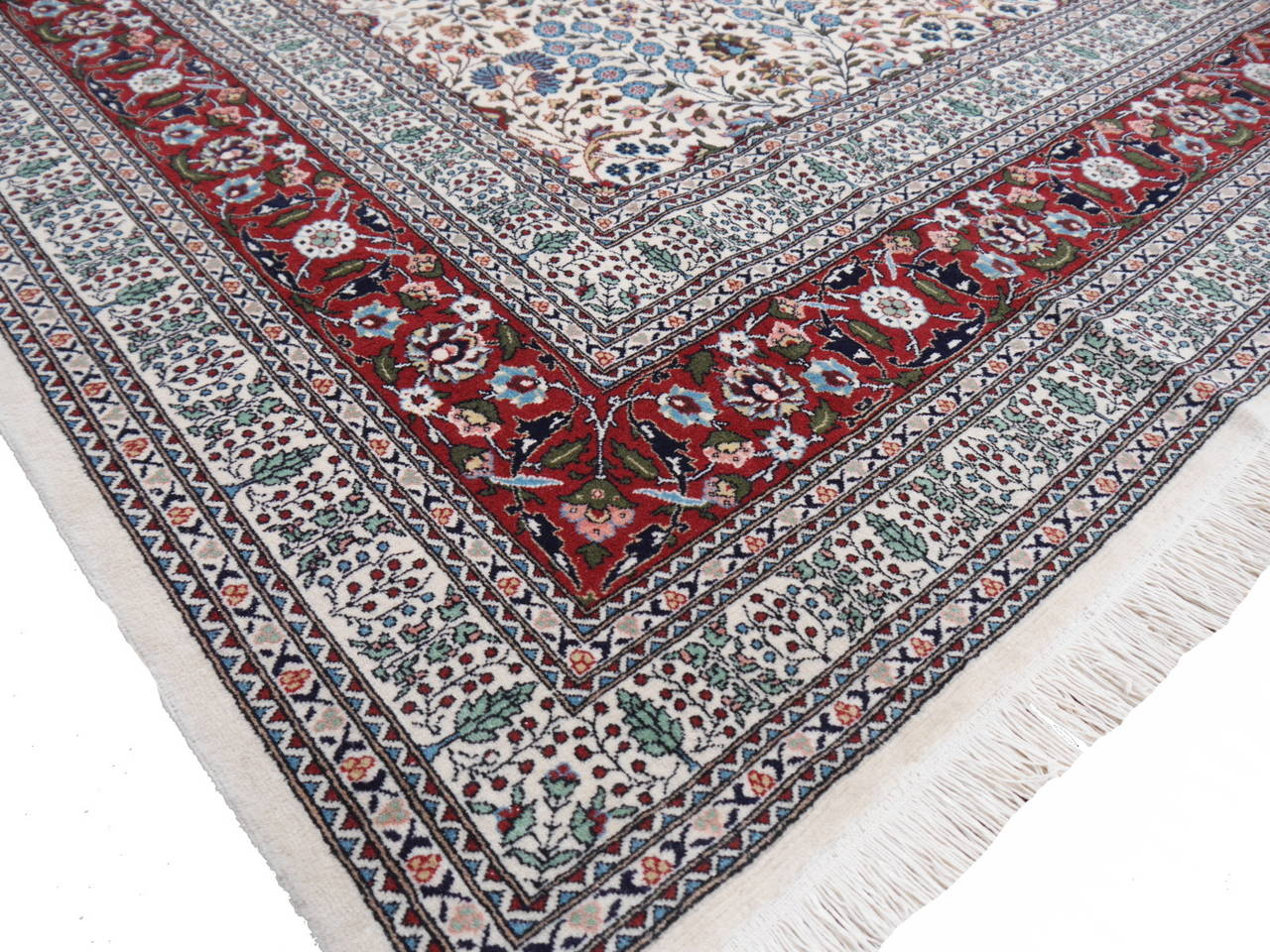 Oversize Turkish Hereke carpet with floral all-over design. Fine wool pile and high knot density result a fine and detailed look.