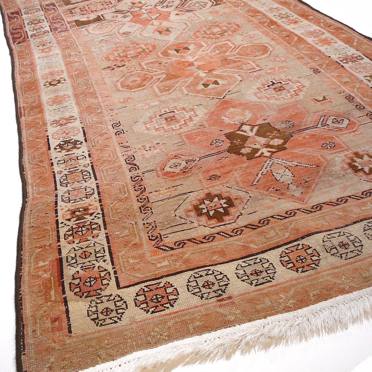 Beautiful antique Caucasian Karabagh rug. Nice low pile condition with restored edges and fringes. Great colors. The colors faded with age.