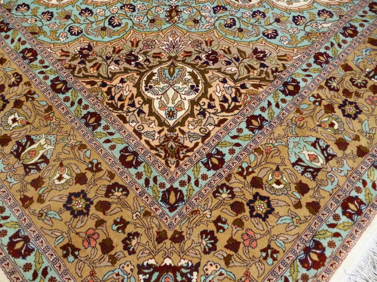 Elegant formal rug from the City of Hereke in Turkey. Very large size for a rug this fine. Light interiour field and floral design make a nice contrast with bronze medaillon and border. This semi antique carpet is in a very beautiful high pile