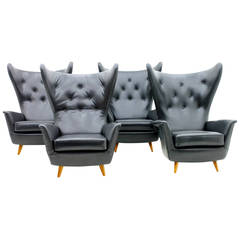 Rare Set of Four Black Leather Wing Lounge Chairs, 1950s