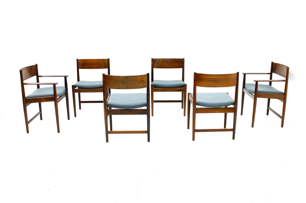 Set of six Kurt Ostervig dining chairs made by Sibast, Denmark. Two chairs with armrests. Light blue fabric.  Good condition.