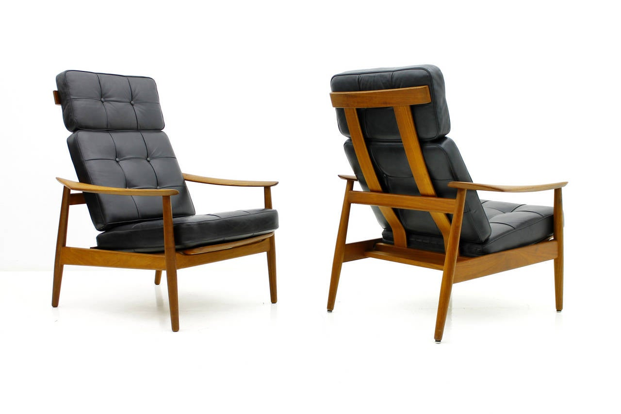Danish Reclining Lounge Chairs, Teak and Leather by Arne Vodder, 1960. Three-position reclining feature built into the Teak Wood frame. Black Leather cushions.   Excellent Condition!