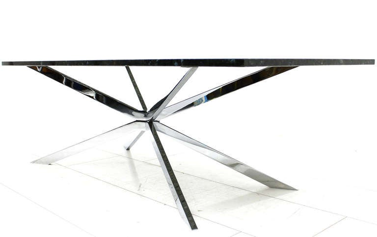 Beautiful sofa table from the early 1970s. Chromed steel base and black labrador granite top.  Measures: L 150 cm, T 70 cm, H 47 cm.  Very good original condition!  We offer worldwide shipping to your doorstep. If a shipping price is not included in