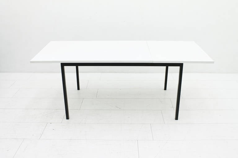 Rare extension dining table by Hans Koenecke germany 1950s. Lacquered steel, laminated wood. Tecta circa 1950s.  130 cm (+65 cm)  x 65 cm x 73 cm  Very good Condition.