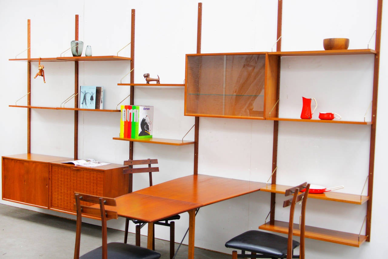 Shelving system by poul cadovius royal teak mid century for Mid century modern danish furniture