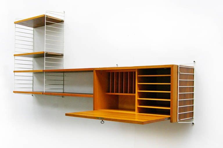Nisse Strinning mid century modern wall unit by nisse strinning string teak shelving