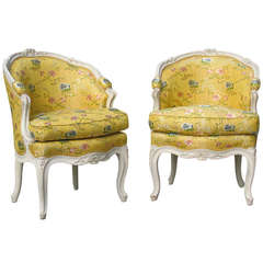 Pair of Louis XV white painted Bergeres en corbeille, circa 1755.