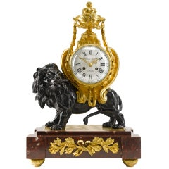 19th Century Louis XVI Style Gilt and Patinated Bronze Mantel Clock of a Lion