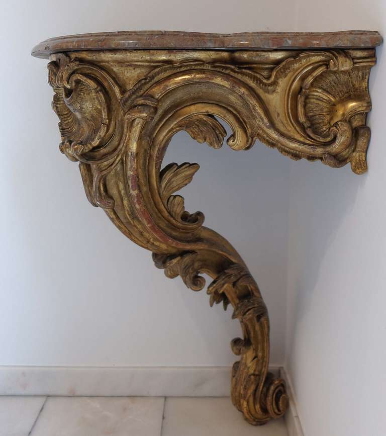 Carved French Louis XV, Mid-18th Century Giltwood Corner Console For Sale