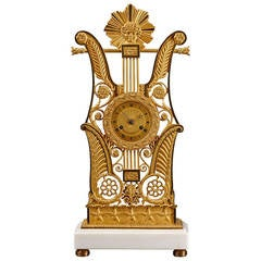 French Restauration Period Ormolu Lyre Mantel Clock with Apollo Mask