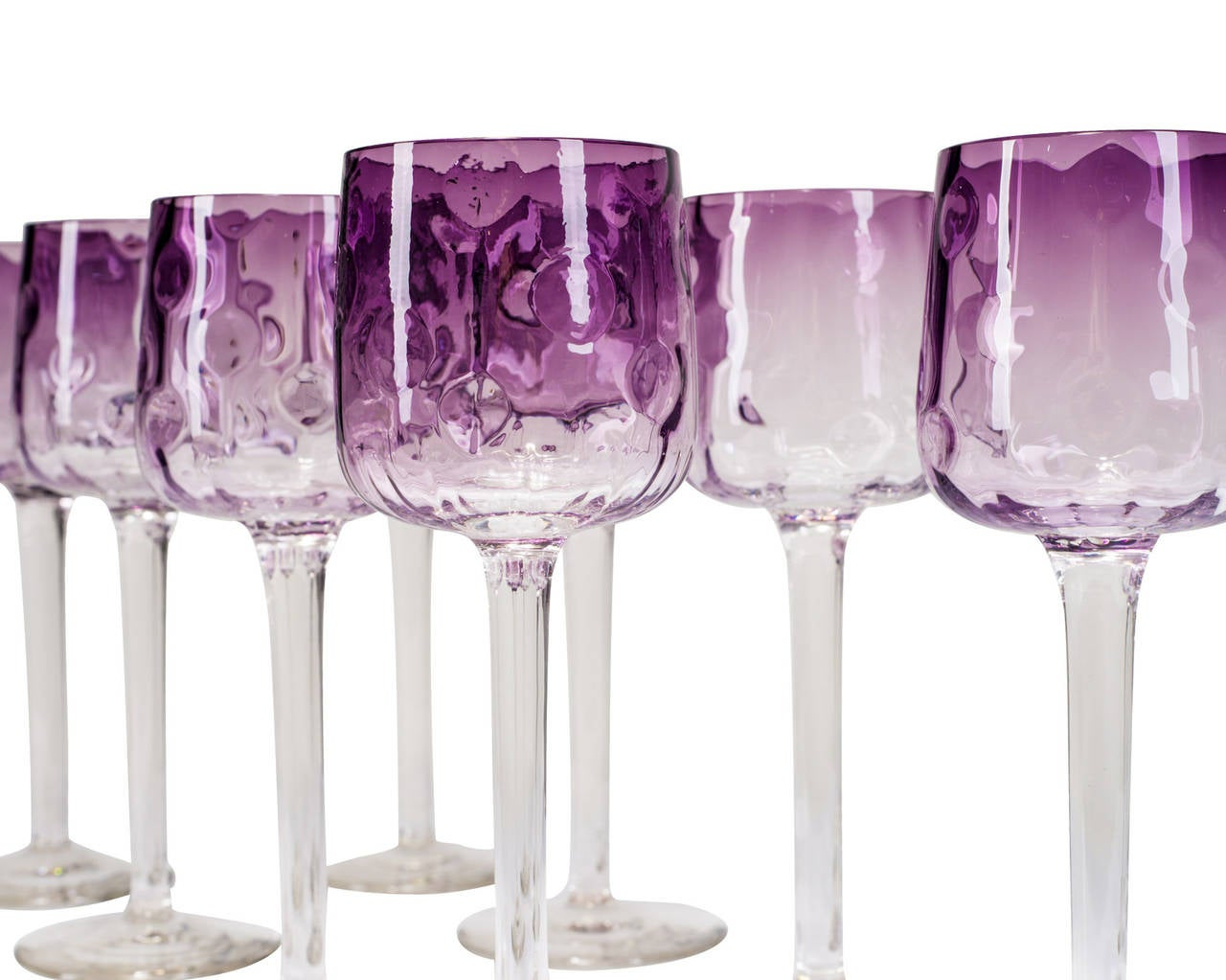 """We are presenting nine long stemmed glasses by Koloman Moser in the same decoration variant """"Meteor"""". This type was not part of the complete table service but was distributed  along with the set by Bakalowits in Vienna. The model differs from the"""