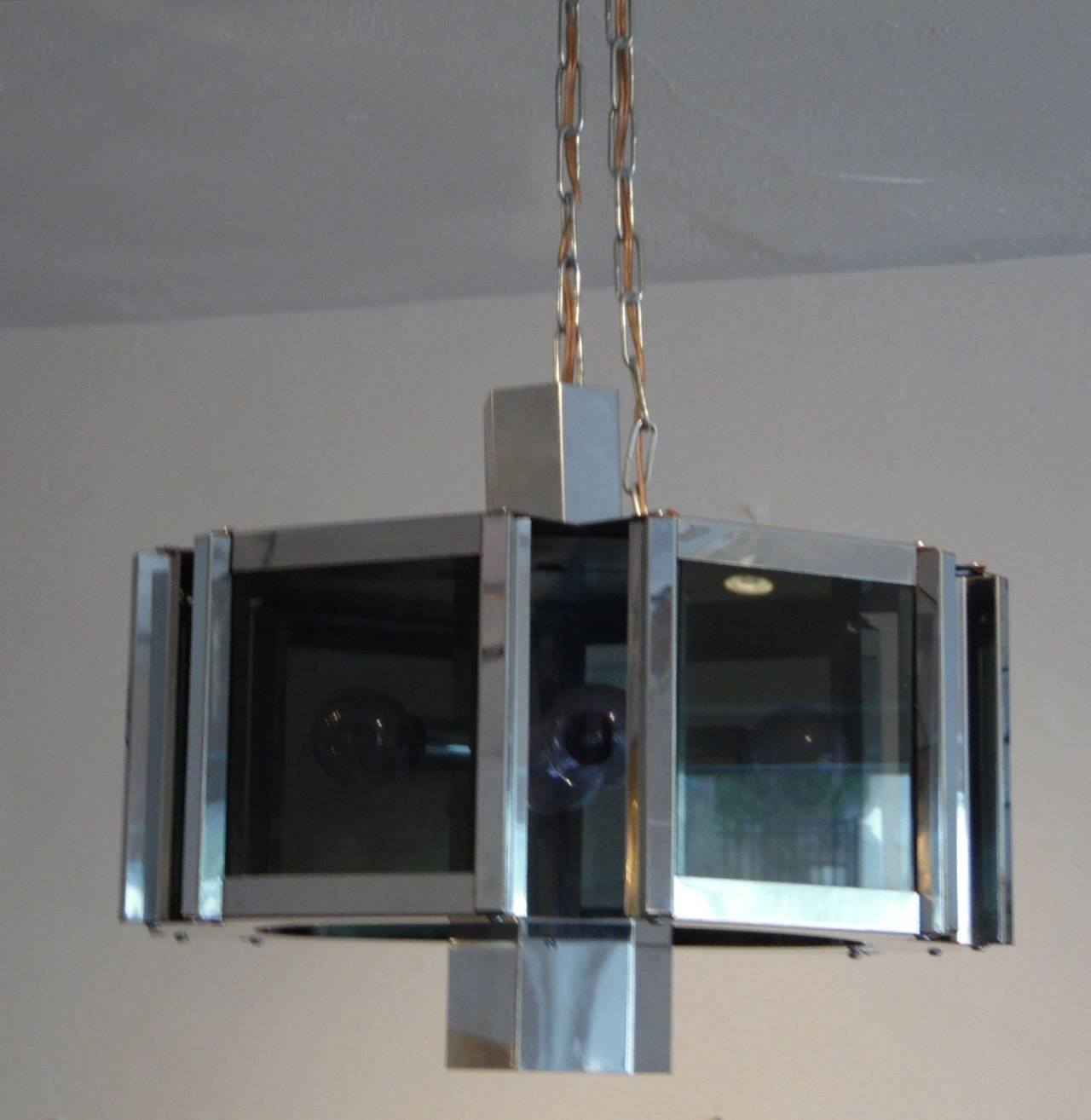Polished Modernist Chrome and Smoked Glass Chandelier by Robert Sonneman For Sale