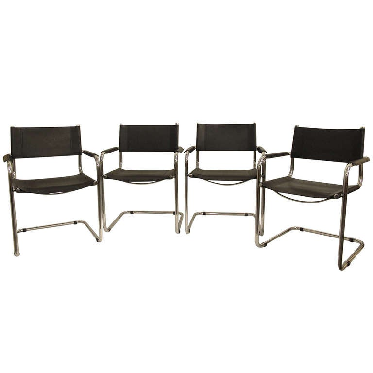 Four leather and chrome dining chairs by mart stam at 1stdibs for Black leather dining room chairs
