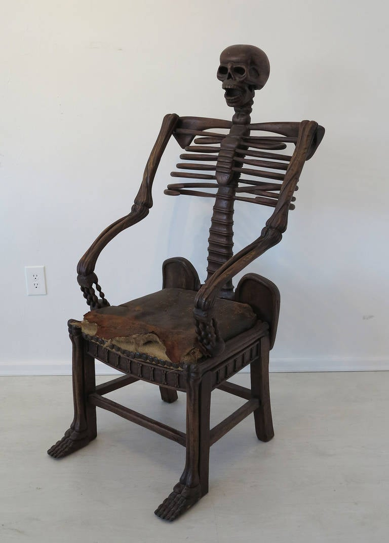 "Unique nineteenth century hand carved ""momento mori"" skeleton chair. This beautifully crafted, very distinctive chair was crafted in walnut, possibly in Europe, and may be modeled after a mid-nineteenth century example illustrated in ""European"