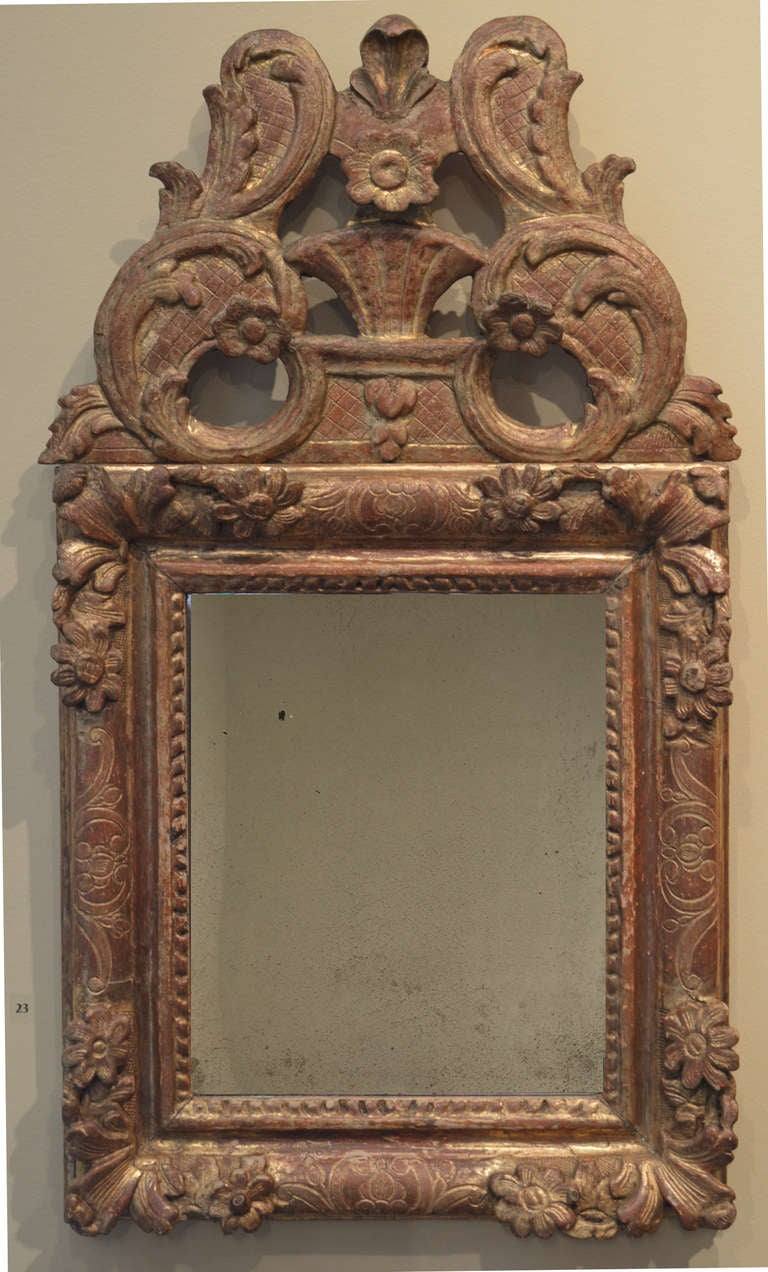 Hand-carved gilded mirror, circa mid-18th century.