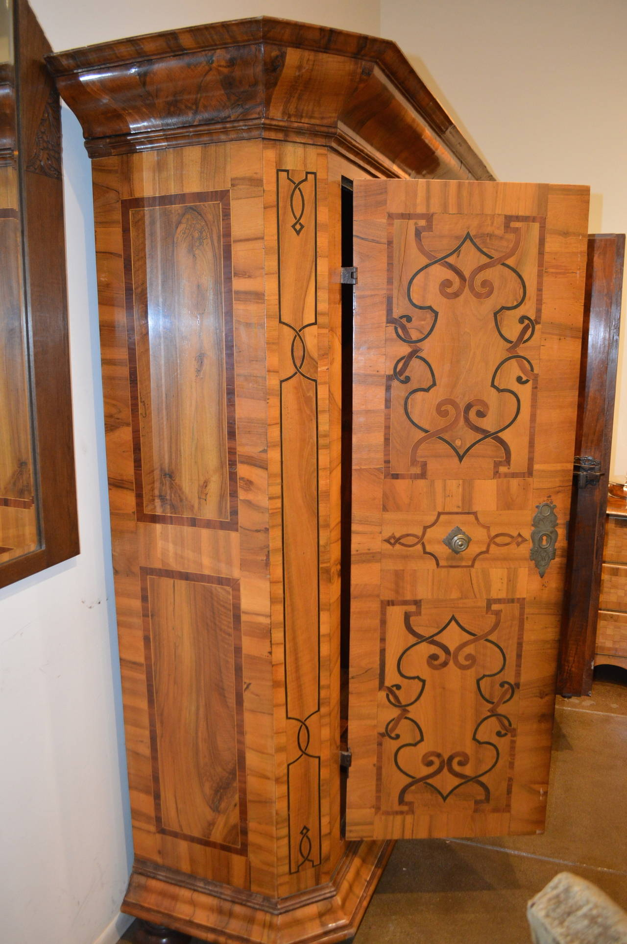 Magnificent antique Austrian armoire with multiple walnut inlays.