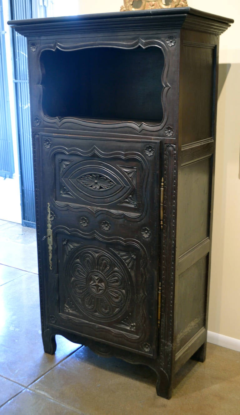 Beautifully hand-carved cabinet from the area of Brittany, France. circa 1900.