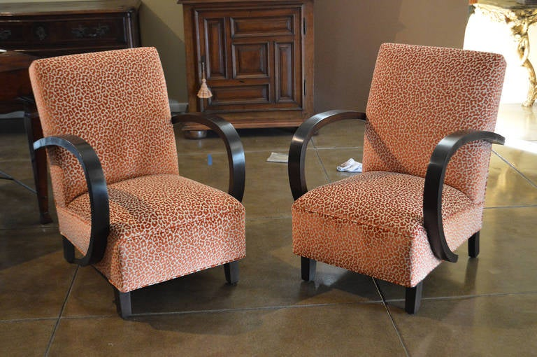 Pair of oak chairs. Upholstery by Timothy Corrigan. He is named one of the world's top 100 interior designers by Architectural Digest and one of the world's top 40 designers by The Robb report.