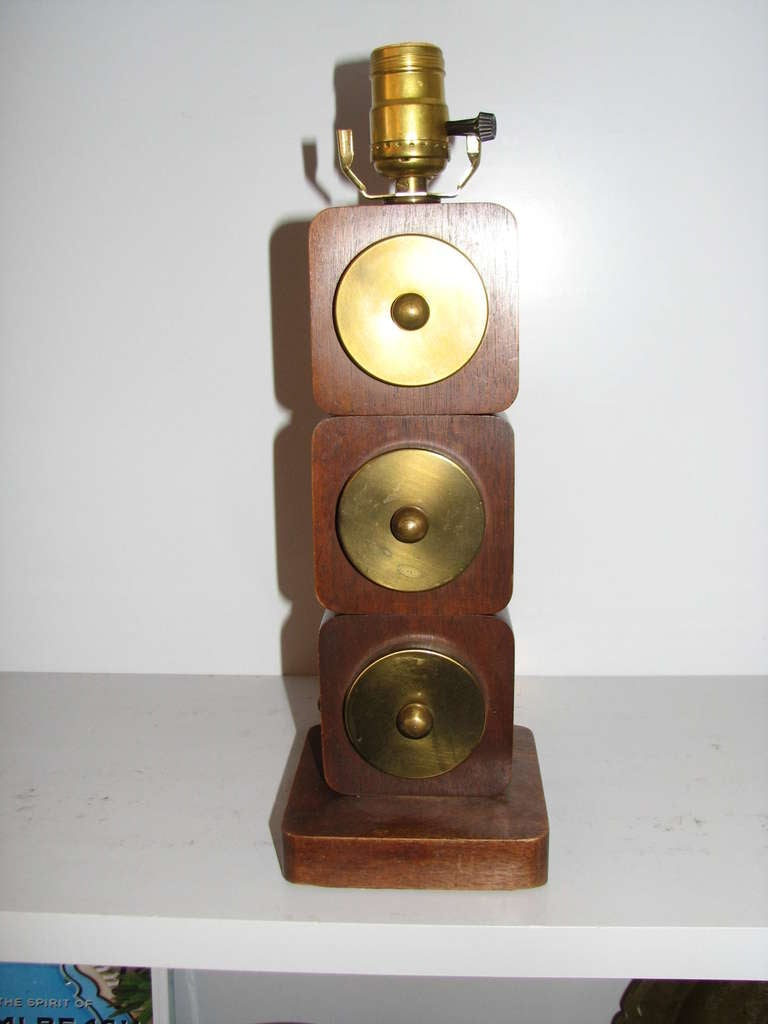 Pair of walnut lamps with brass disc design. No shades. Height is to top of body.