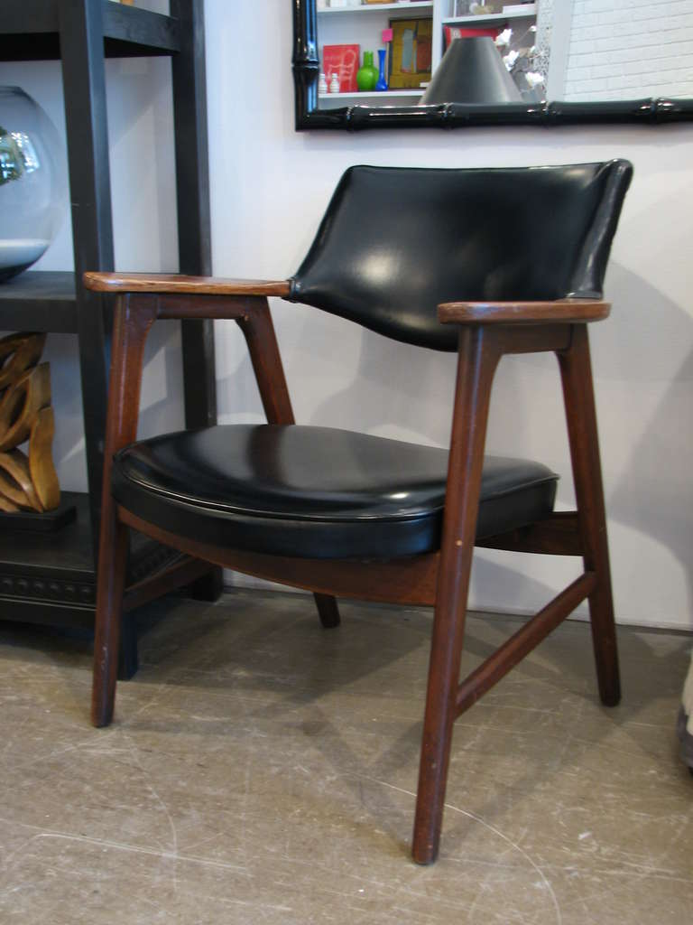 Pair of black vinyl and walnut chairs by Paoli Chair Co & Pair of Paoli Chairs at 1stdibs