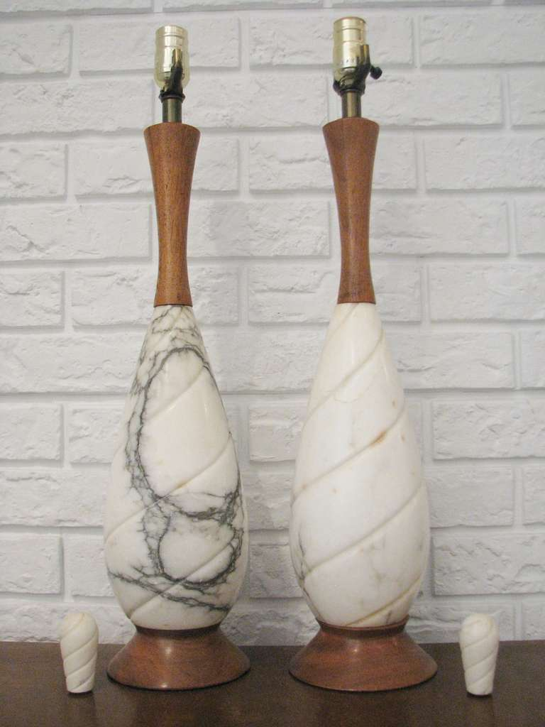 Pair of marble and wood table lamps with marble finials.