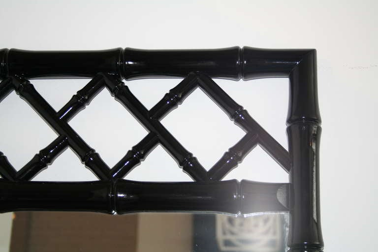 Black lacquered Chinese Chippendale style wood mirrors. 2 available; price shown is per mirror.