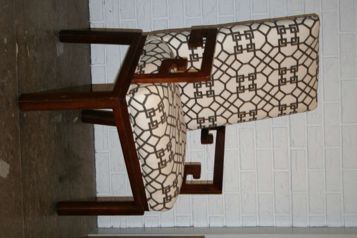 Pair of walnut arm chairs with Greek key arm detail and upholstered in Chinese Chippendale brown and white fabric.