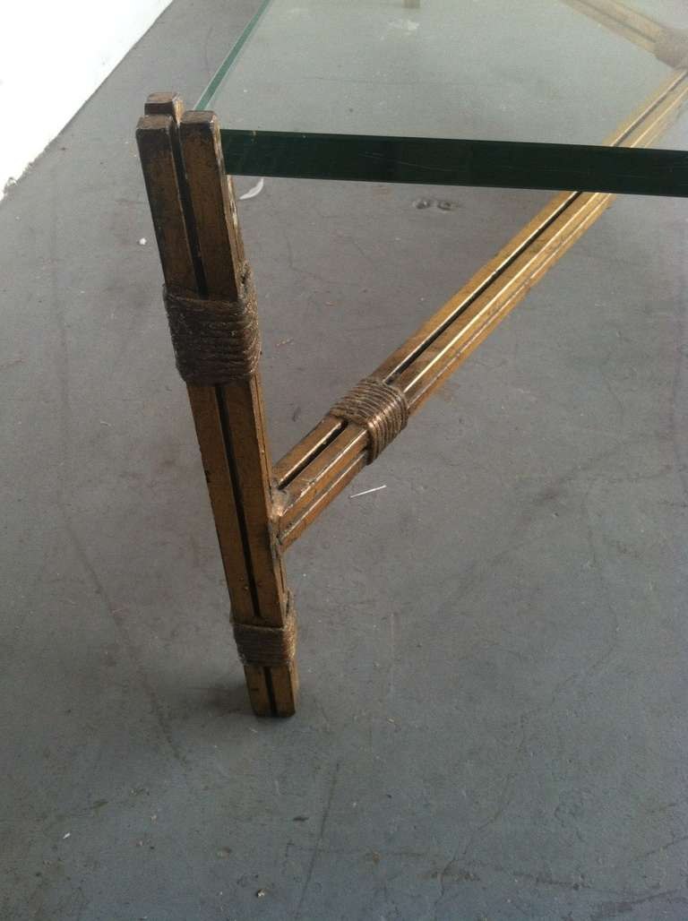 Large glass top coffee table with gold leaf finish on the metal base at 1stdibs Metal glass top coffee table