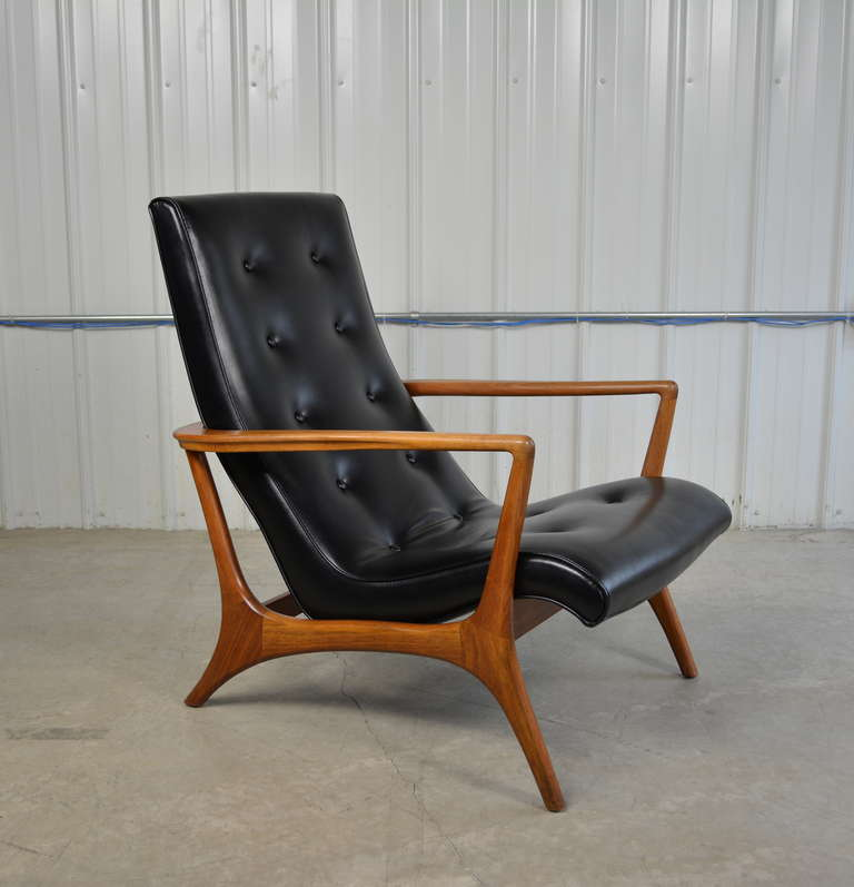 this mid century modern walnut and leather lounge chair is no longer