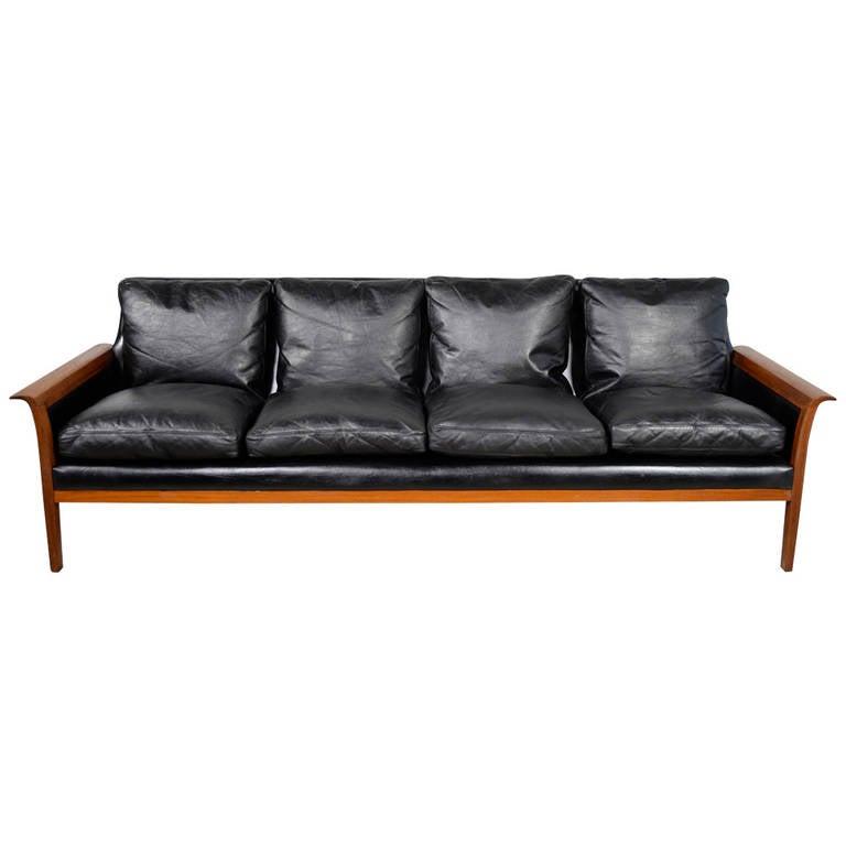 hans olsen danish modern black leather and teak sofa at
