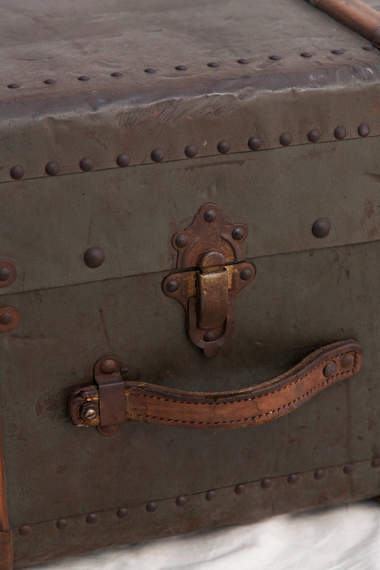 Riveted Metal Traveling Trunk with Wooden Runners 9