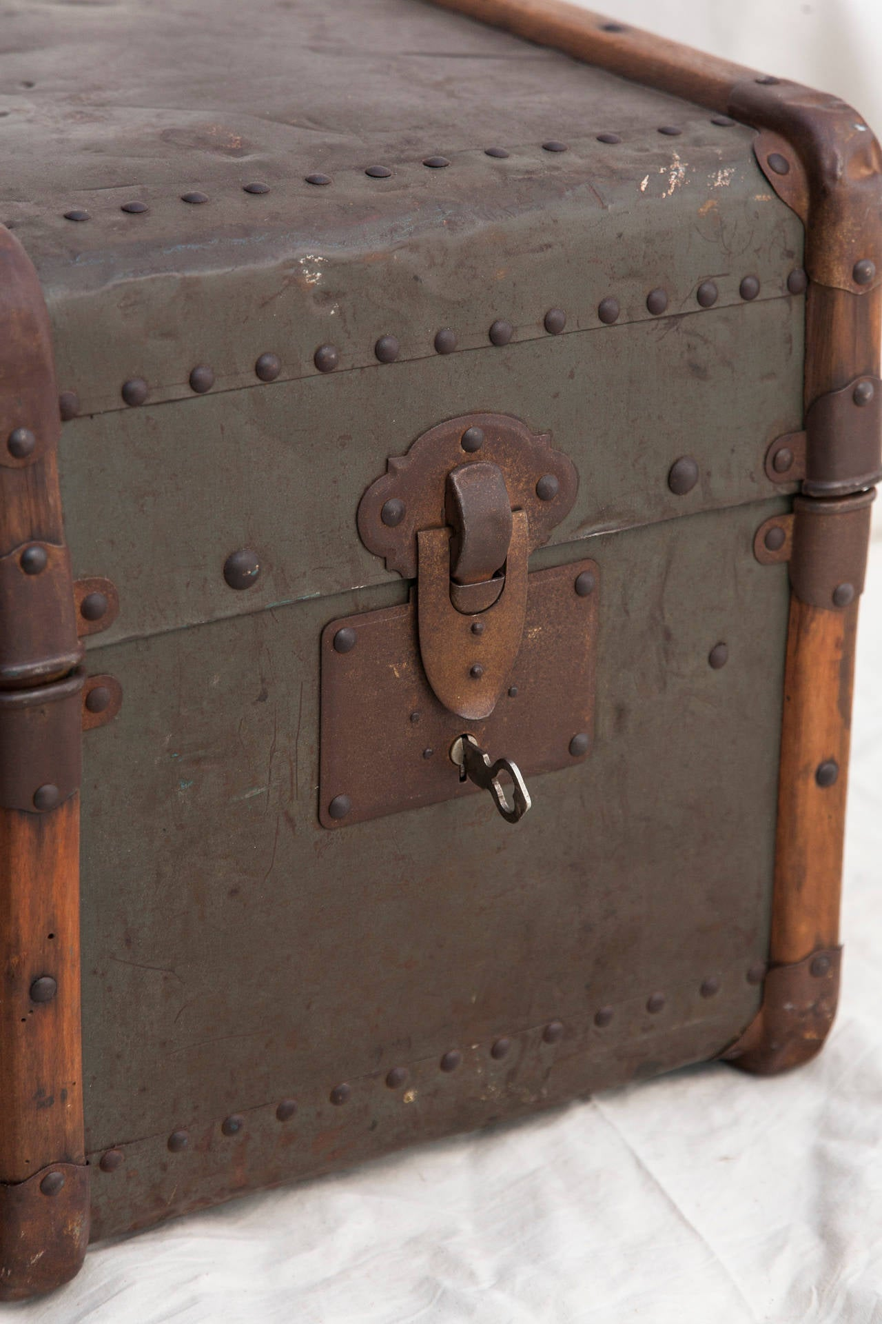 Riveted Metal Traveling Trunk with Wooden Runners 10