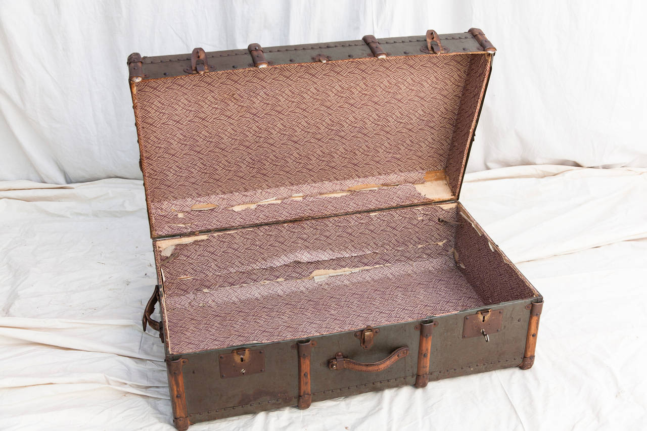 Riveted Metal Traveling Trunk with Wooden Runners 7