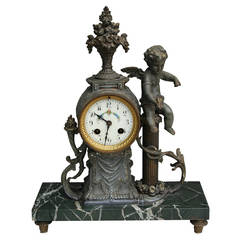 Bronze and Onyx Mantle Clock Featuring Cherub and Bouquet